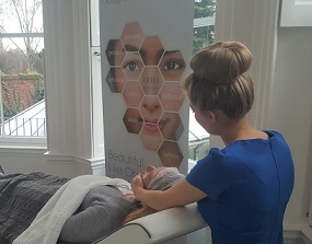 Amber carrying out Obagi facial